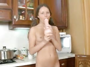 Young Wet Cunt Filled By A Huge Lifelike Sex Toy