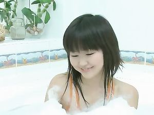 Adorable Asian In A Bubble Bath Masturbates
