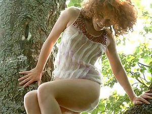 Young Redhead Masturbates In The Woods